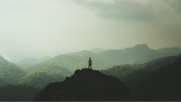Leadership - man on a mountain